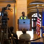 Higher Ground Saint Paul client Arthur speaks at a Homes for All rally in the Capitol Rotunda