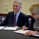 Catholic Charities and the University of St. Thomas celebrate a new partnership
